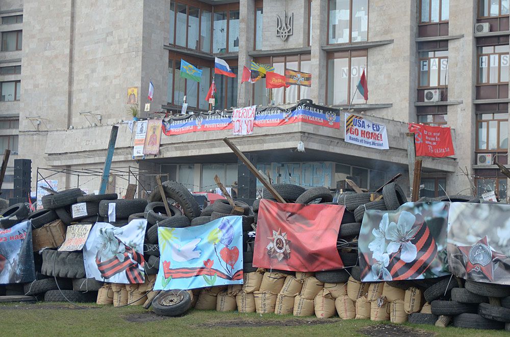 The Donetsk Regional State Administration Building inthe Ukraine was occupied on April 6, 2014 by a group of separatists who declared the creation of the Donetsk People's Republic. Picture taken on April 15 shows the barricade and anti-Western banners outside the RSA building. Picture by: Andrew Butko, Wikimedia Commons