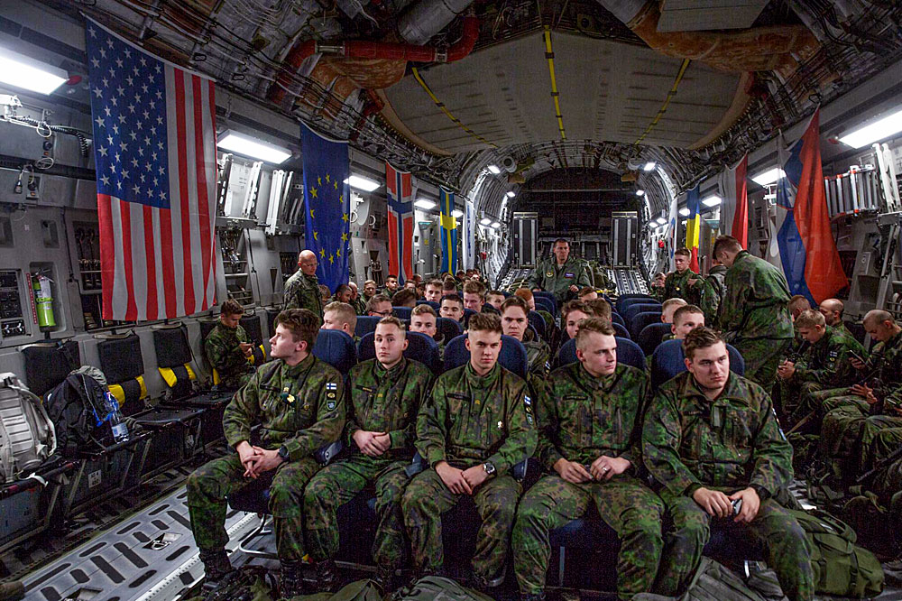 Finnish conscripts flying to Norway to attend the Trident Juncture 2018 excercise. The flight was carried out on a C-17 Globemaster III transport aircraft. The aircraft is part of the Strategic Airlift Capability multinational initiative of which Finland is one of the participating countries. Picture by Finnish Defence Forces