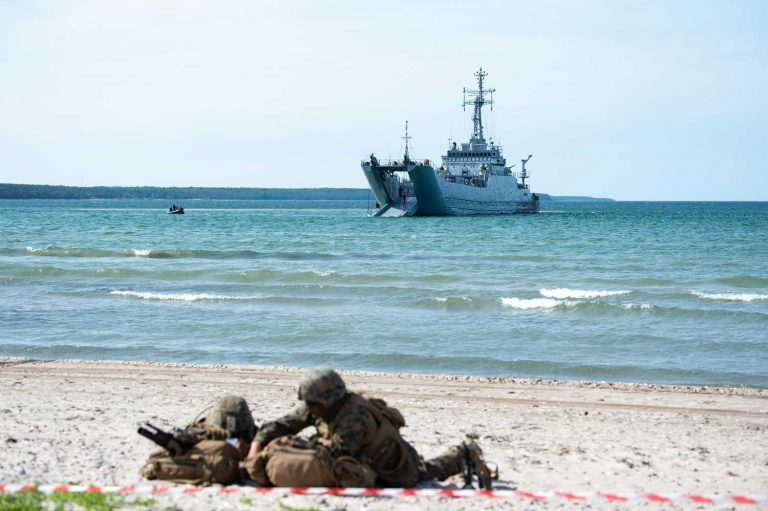 Marines securing a beach.